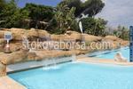 Изграждане от щампован бетон на изкуствени скали за басейни